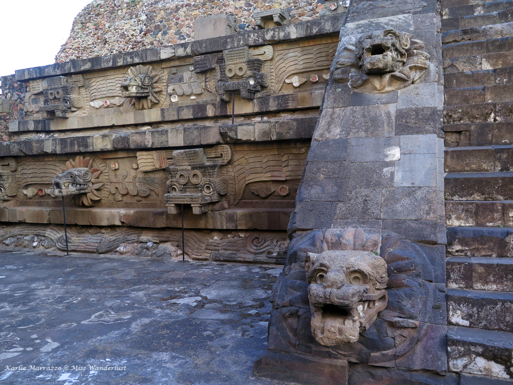 Close up detail of carved figures on the Temple of the Feathered Serpent at Teotihuacan