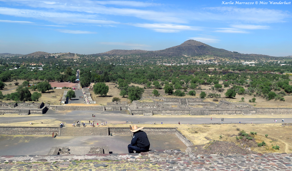 A vendor sits down on the steps of the Pyramid of the Sun at Teotihuacan.