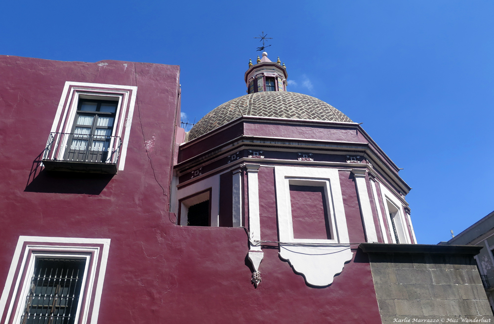 A maroon building in Puebla, Mexico.