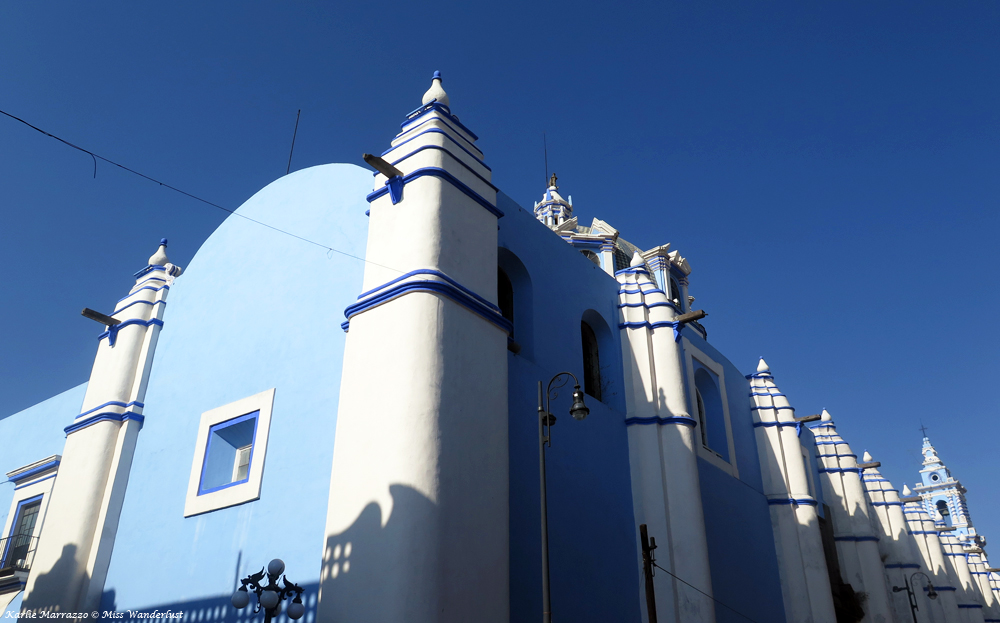 A baby blue church against the blue sky in Puebla, Mexico.