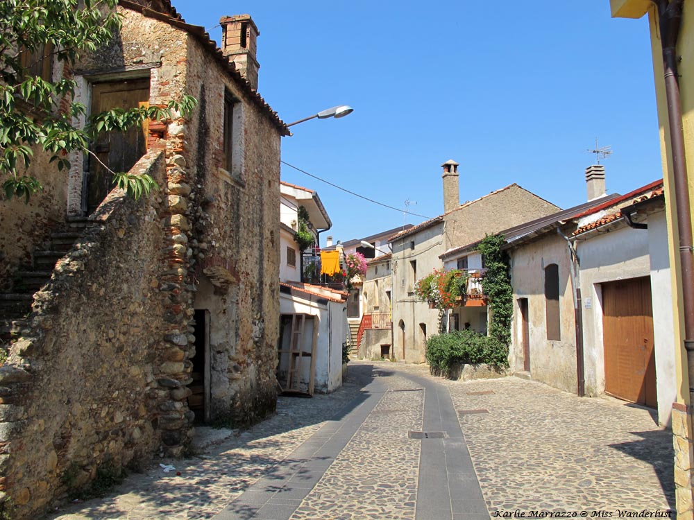 A narrow cobblestone street in the village of Donnici Superiore, Italy