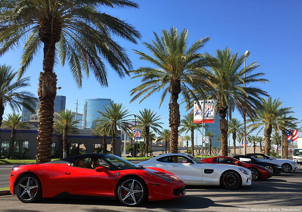 A Ferrari 458 Spider, a Mercedes AMG and a McLaren 12C in a parking lot in Las Vegas