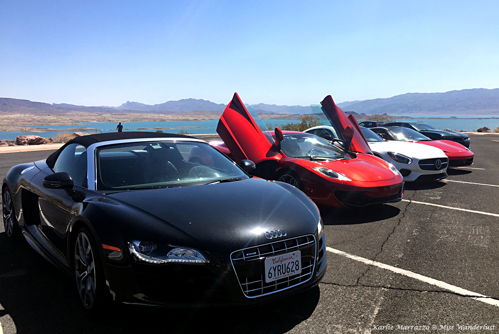 A black Audi R8, a red Ferrari 458 Soider, a white Mercedes-AMG and a McLaren 12C in a row at Lake Mead, Nevada