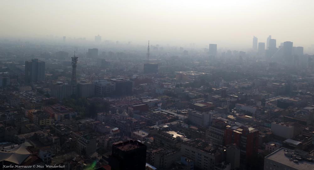 Smog fills the sky over the heart of Mexico City.