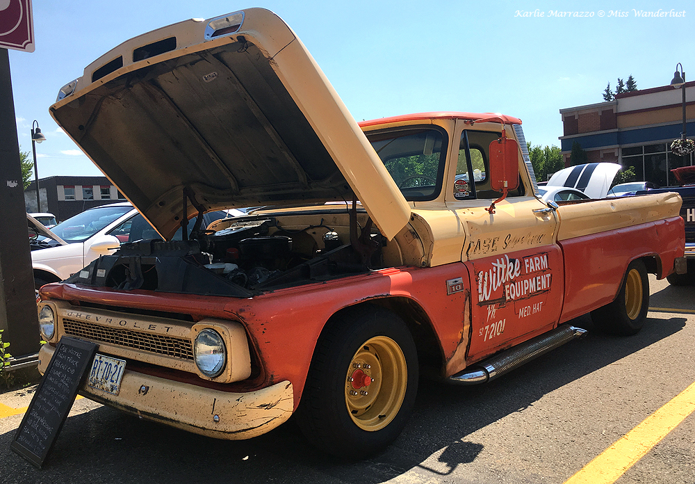 A cream and orange coloured 1960s Chevy farm truck