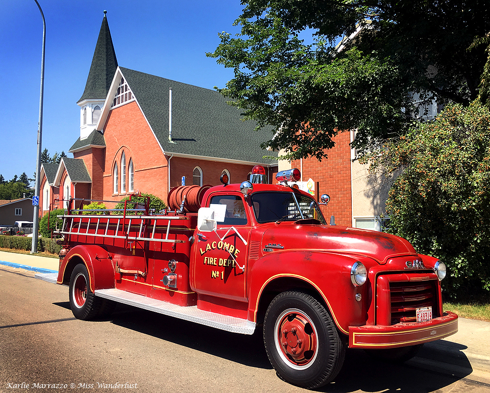 A red 1940s fire truck in the town of Lacombe