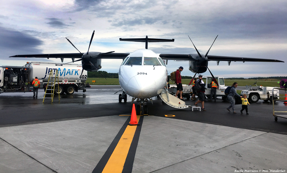 A front view of a Dornier 328 prop plane on the tarmac at the Prince George Airport