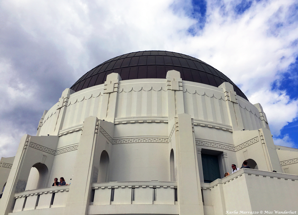 A close up shot of the art deco white dome of the Griffith Observatory in Los Angeles