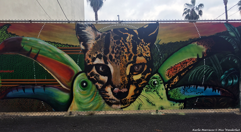 street art in los angeles depicting a baby cheetah and two tucans